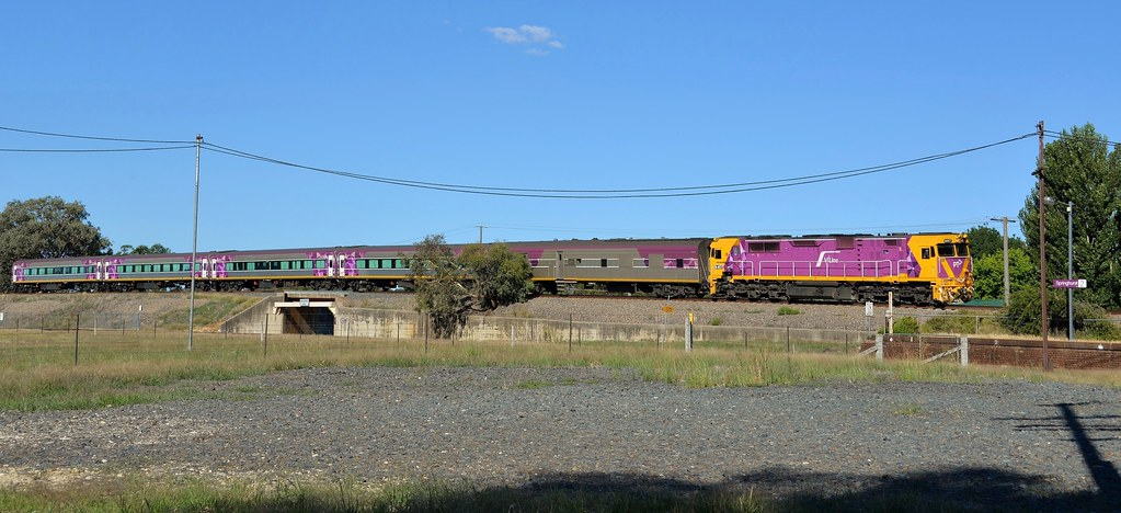 Wearing the new corporate colours and livery, N457 brings the 5:20pm Albury to Melbourne service into Springhurst, Vic by Adam Serena
