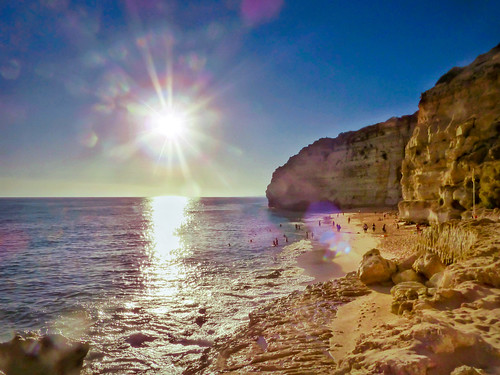 landscape coast coastal beach sea water rocks sunset