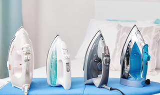 lineup of four steam irons on blue board | by yourbestdigs