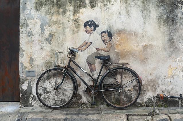 Penang. Children on a Bicycle / Пенанг. Дети на велосипеде
