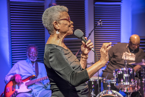 Germaine Bazzle at WWOZ. George and Gerald French in the background. Photo by Marc PoKempner.