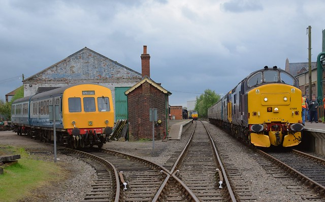 Class 101 DMU to the left, 57007 in the centre background and 37688 & 37424 on the right create a busy scene at Dereham. 01 05 2017