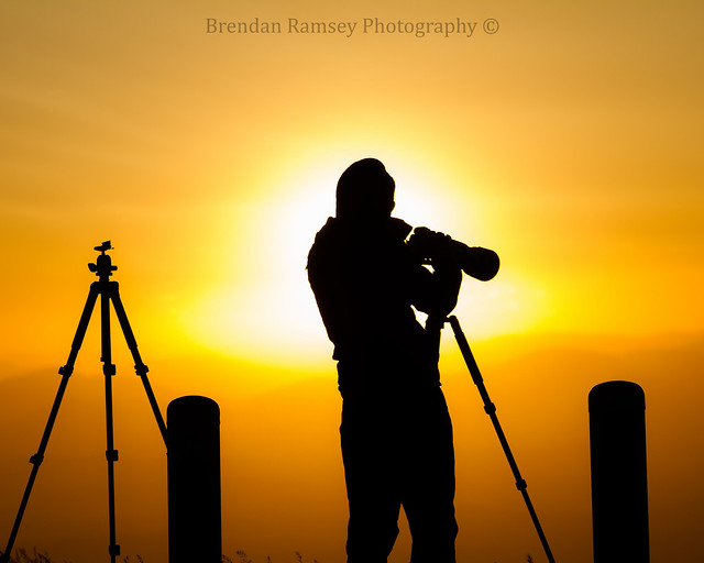 A photographer's silhouette.