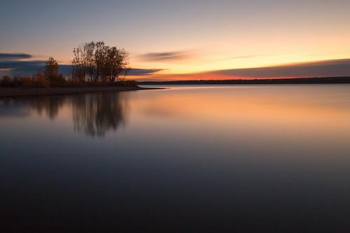sunrise dawn daybreak lake clouds sky silhouettes trees le longexposure landscape chatfieldstatepark lakechatfield colorado