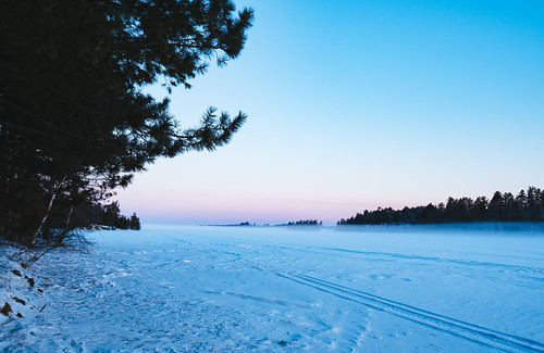 lakevermilion minnesota fog frozen lake snow snowmobiletracks sunrise trees winter