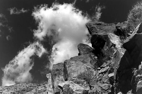 tahquitz canyon tahquitzcanyon palmsprings palmspringsca palmspringscalifornia california ca kodak tmx tmax kodaktmx kodaktmax kodaktmx100 black white blackandwhite blackandwhitefilm blackwhite bw monochrome monotone kodakmedalist 620 620film landscape clouds boulder rock rockformation sky cahuilla caliente aguacaliente irrigationditch beerol beerenol pabstblueribbonbeer caffenol