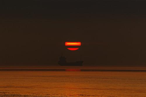 sunrise coaster vessel morning sun early humberestuary humberside water ship clouds sunlight silhouette fullframe canoneos1dxmkll ef100400 handheld