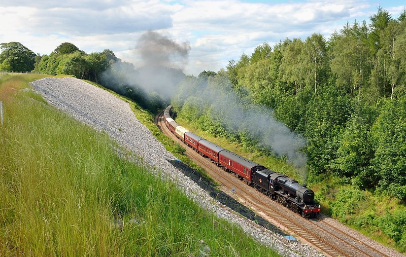 As a comparison to the shot of 60009 alongside,48151 with a southbound Fellsman on 9/7/2014 Considerable work has been done to make the cutting shallower,remove the trees and improve drainage.The rear of the train is passing the site of the later landslip at Eden Brows. Copyright David Price No unauthorised use