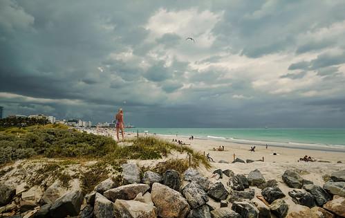 beautifulpeople miamibeach sobe southpoint clouds seashore seascape people rock sea seagull urban walkingaround waterways beachscape beachshore outdoors