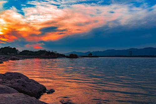 lakhwal islamabadcapitalterritory pakistan pk islamabad sunset sundown sunlight cloudscape clouds golden orange hour blue rocks lake water landscape trees island canon 6d rawal