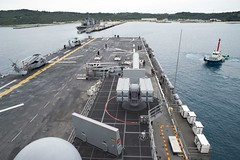 USS Bonhomme Richard (LHD 6) approaches a pier at White Beach Naval Facility, March 8. (U.S. Navy/MC2 William Sykes