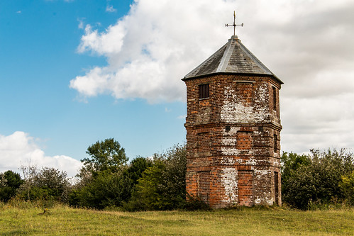 pepperbox pepperpot folly tower brick hexagonal building architecture hill down wiltshire nationaltrust landscape field grass tree bush sky