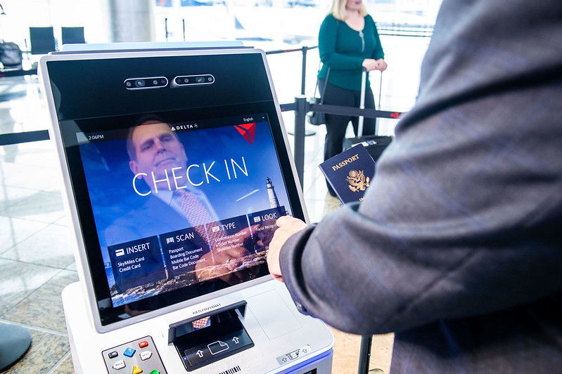 Customer checks in at self-service kiosk using facial recognition option