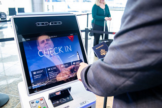 Customer checks in at self-service kiosk using facial recognition option | by DeltaNewsHub
