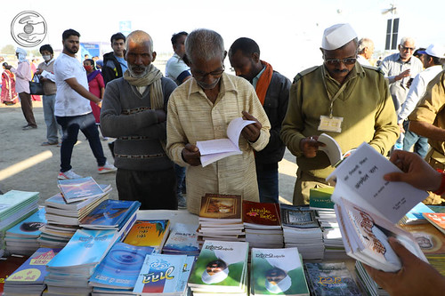 Devotees picking-up Mission's literature at one of the Publication Stalls
