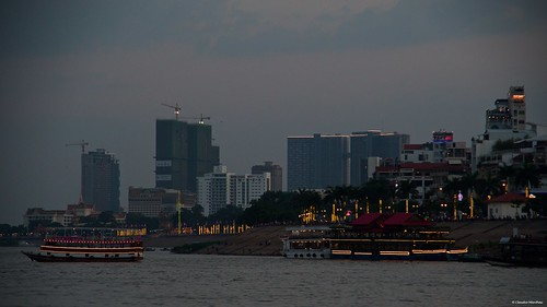 mekongriver phnompenh cambodia mekong river phnom penh sunset golden hour silhouette water cityscape sunny day sun sky redsky pentax pentaxkp pentax18135 pentaxlens pentaxart asia happy planet favorites boat ferry lights lake happyplanet asiafavorites