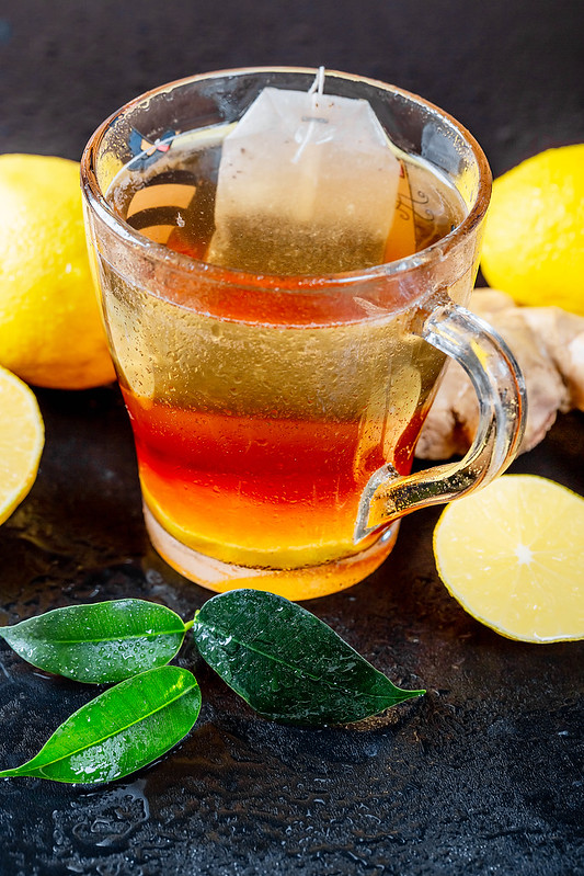 Green tea with lemon and fresh tea leaves