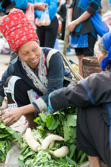 Red Dao Woman Buying Vegetables