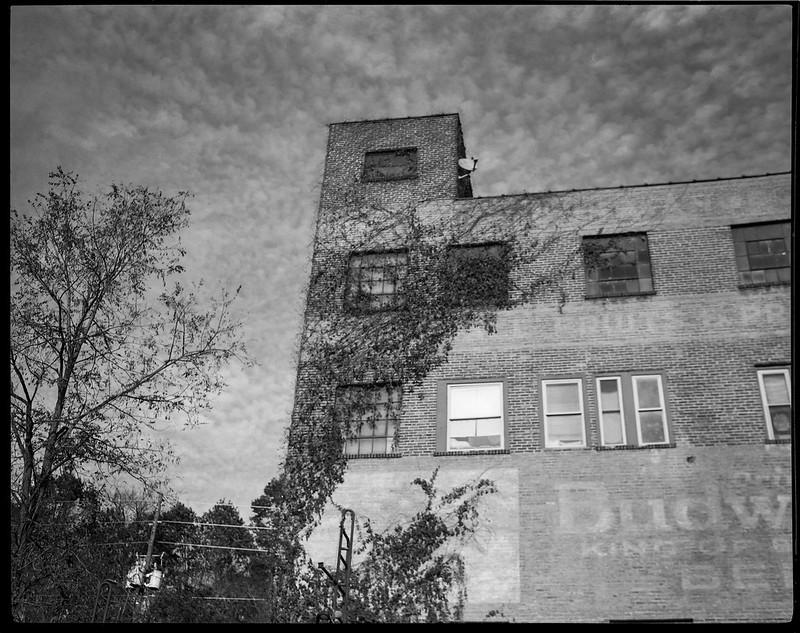 old brick warehouse, dappled sky, River District, Asheville, NC, Koni Omega Rapid 100, Super Omegon 90mm f-3.5, Arista.Edu 200, Ilford Ilfosol 3 developer, 11.2.18