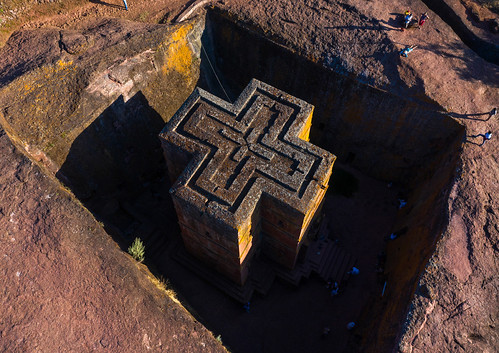 aerialview africa amhararegion ancient architecture builtstructure carving christianity church colourimage colourpicture cross day drone ethiopia ethiopia18dr0235 famousplace giyorgis history horizontal hornofafrica incidentalpeople internationallandmark lalibela medieval monolithic monument orthodox orthodoxchurch outdoors photography placeofworship religion rock saintgeorge scenics spirituality stgeorge stgeorgeschurch traveldestinations unescoworldheritagesite et