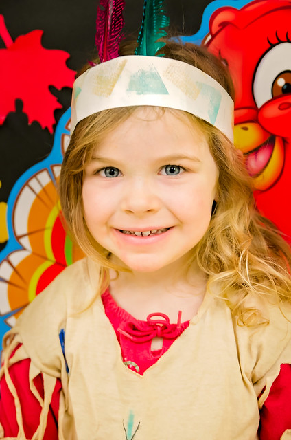 Pre-school girl dressed in homemade Native American Indian costume for Thanksgiving