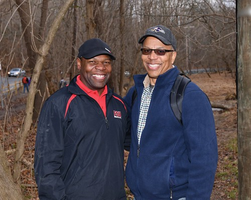 Photo of two men in the woods