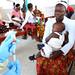 Nurse prepares to vaccinate children