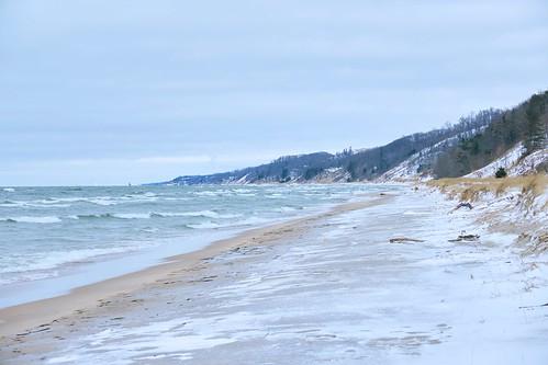 lake lakeshore lakemichigan dunes woods ice snow beach waves clouds vanishingpoint