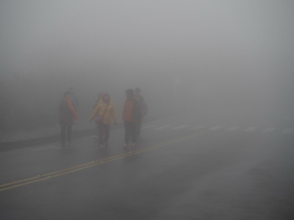 A group of tourists lost in the misty mountain at Yangmingshan National Park