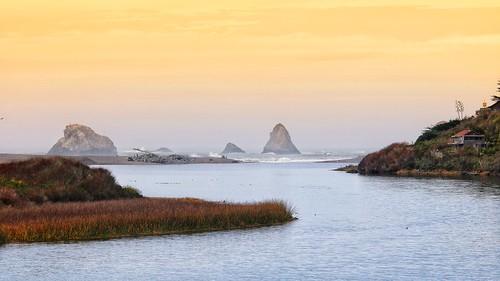 russianriver jenner island river sunset driftwood seastack beach waves house