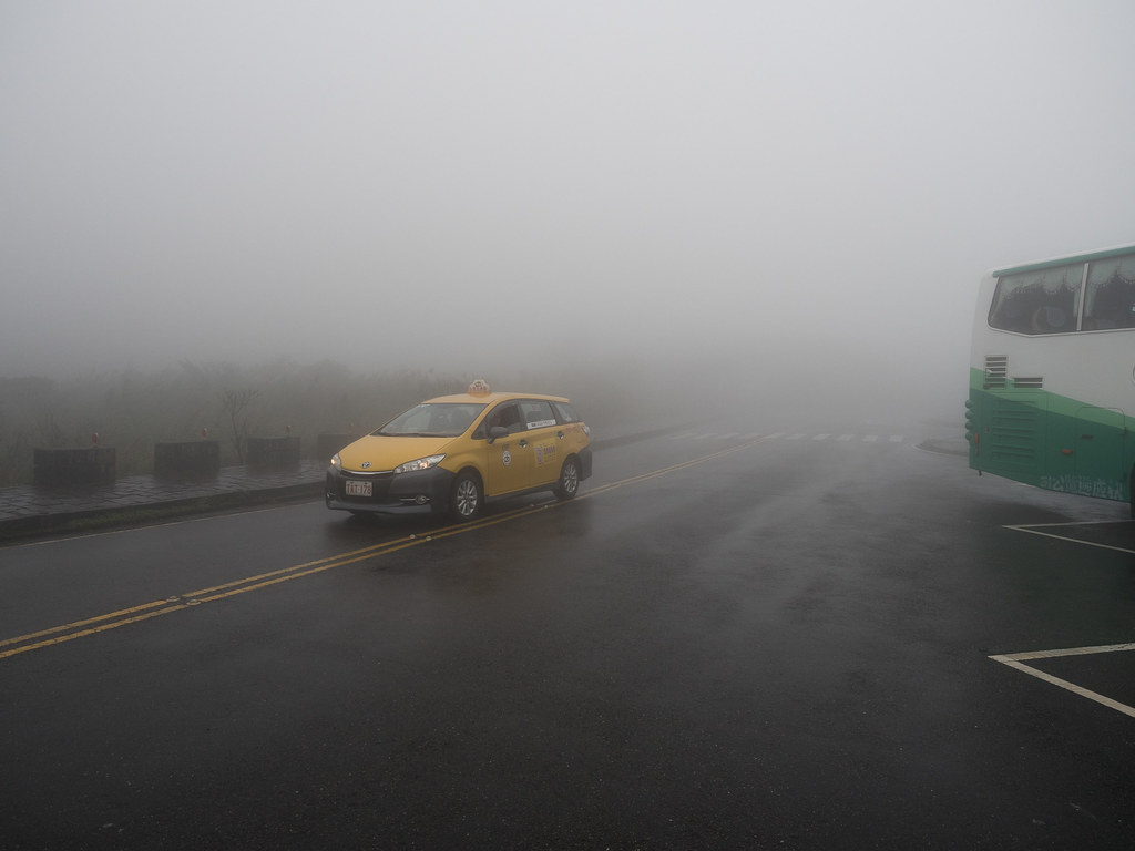 A local taxi at misty Yangmingshan National Park.