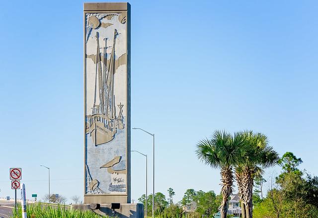 Shrimp boat bas relief art on Bay Saint Louis Bridge in Bay Saint Louis Mississippi