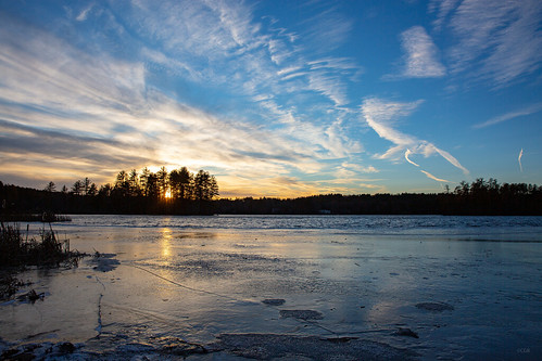 winter ice pond water sunset sun blue sky clouds nh hudson robinson new england