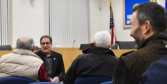 Rep. John Fusco talks with a constituent during a town hall meeting at the John Weichsel Municipal Center.
