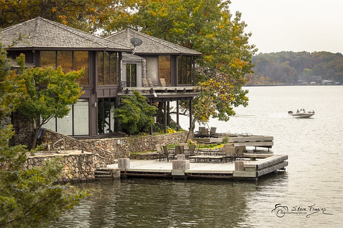 lakeoftheozarks camdencounty missouri mo shore shoreline treetopvillage boat speedboat powerboat wake dock deck house home water waves autumn foliage colorful landscape waterscape stonewall beautiful stevefrazierphotography