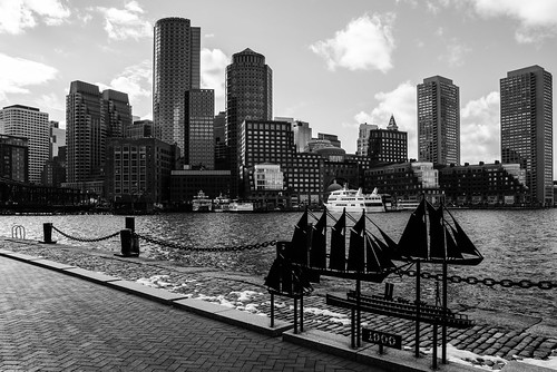 newengland massachusetts boston skyline architecture buildings sky harborwalk ships boats pier blackandwhite bw monochrome clouds ocean skyscrapers modern city urban seaside water chain tall