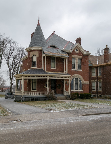 house dwelling residence paris kentucky unitedstatesofamerica us historic queenanne romanesque sidewalk bushes hedges shrubbery street bourboncounty twostory brick porch turret stonework polychromatic stringcourse roundarched picturewindow chimney 11windows johnmcclintock 1889
