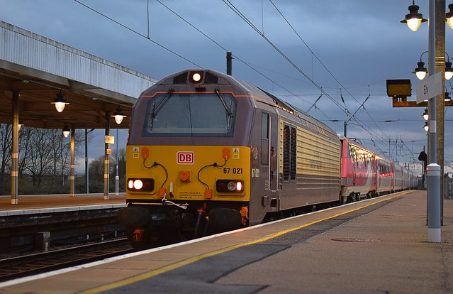 DB Schenker Belmond Pullman liveried 67021 rolls through Ely, with the diverted 14.32 Kings Cross to Edinburgh LNER service. 13 01 2019