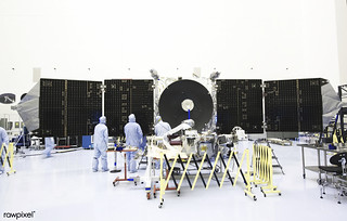 Inside the Payload Hazardous Servicing Facility at NASA's Kennedy Space Center in Florida, engineers and technicians prepare to install a radome over the antenna for the Mars Atmosphere and Volatile Evolution, or MAVEN, spacecraft. Original from
