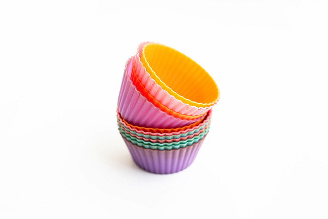 Colorful silicone muffin cups on white background