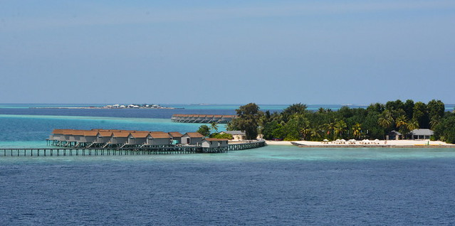 SMALL OCEAN SIDE CABINS IN THE MALDIVE ISLANDS,  INDIAN OCEAN.