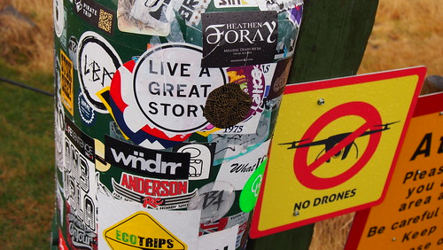 only pole at Iceland waterfalls sticker bombed in English