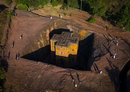 aerialview africa amhararegion ancient architecture builtstructure carving christianity church colourimage colourpicture cross day drone ethiopia ethiopia18dr0241 famousplace giyorgis history horizontal hornofafrica incidentalpeople internationallandmark lalibela medieval monolithic monument orthodox orthodoxchurch outdoors photography placeofworship religion rock saintgeorge scenics spirituality stgeorge stgeorgeschurch traveldestinations unescoworldheritagesite et