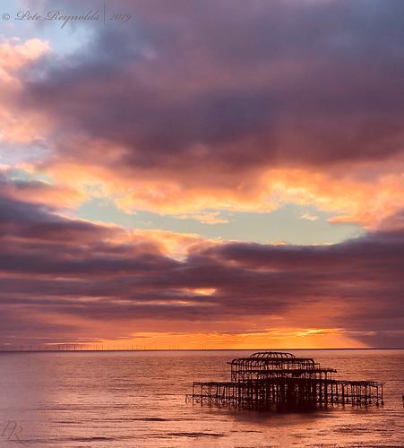 sunset pier brighton reflection sea water sky skies england south coast horizon wind farm windfarm westpier west thegrandhotel dusk evening