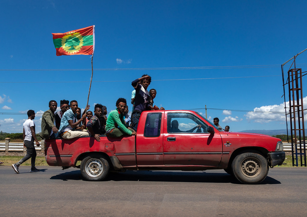 Men in a car celebrating the oromo liberation front party