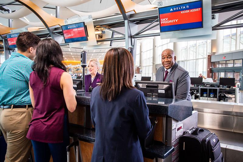Customer drops off checked bag at counter