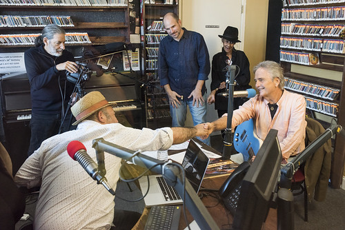 Marc Stone shakes Spencer Bohren's hand at WWOZ's 38th birthday - 12.4.18. Photo by Ryan Hodgson-Rigsbee rhrphoto.com. Charlie Steiner, Scott Borne, Dee Lindsey hard at work.
