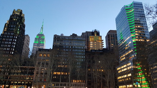 Bryant Park Hotel, The Empire State Building NHL & NHP lighting in green in honor of Earth Day & 7 Bryant Park as seen from Bryant Park in Midtown Manhattan in New York City, NY