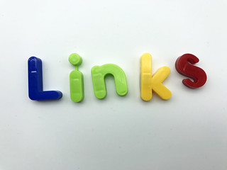 Coloured letters spell out the word 'links' against a white background flat lay | by tecmark UK