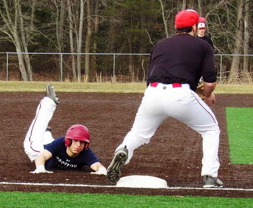 Eastern Regional's Matt Karpousis gets extra low on a slide into third. | by tedtee308